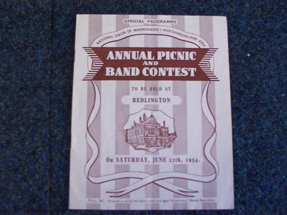 Front page of a Northumberland Miners' Picnic Programme. 'Official Programme / National Union of Mineworkers Northumberland Area / Annual Picnic / And / Band Contest / to be held at / Bedlington / on Saturday, June 12th, 1954'. Lead image shows a line drawing of a building.