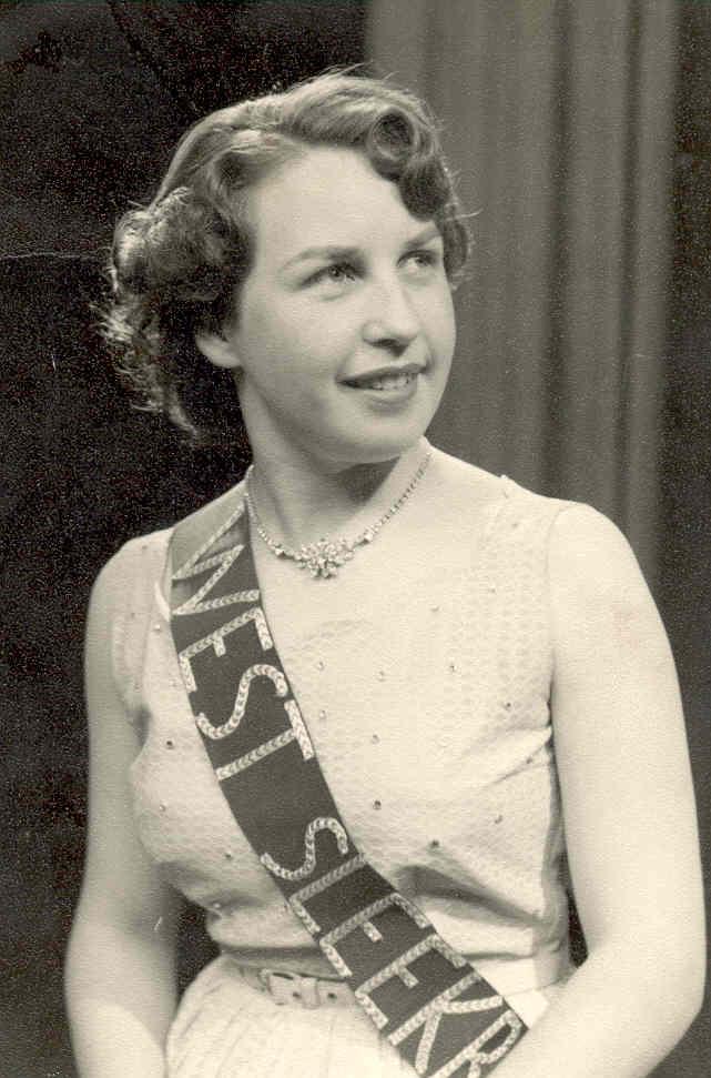 Black and white photograph of Elizabeth Storey as Miss West Sleekburn. Formal studio portrait.