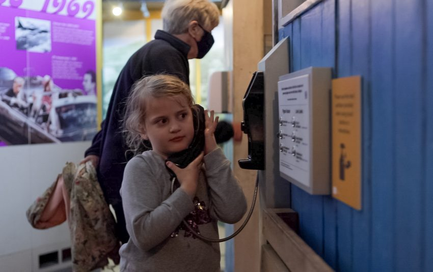 Girl using the telephone in Coal Town Exhibition at Woodhorn Museum