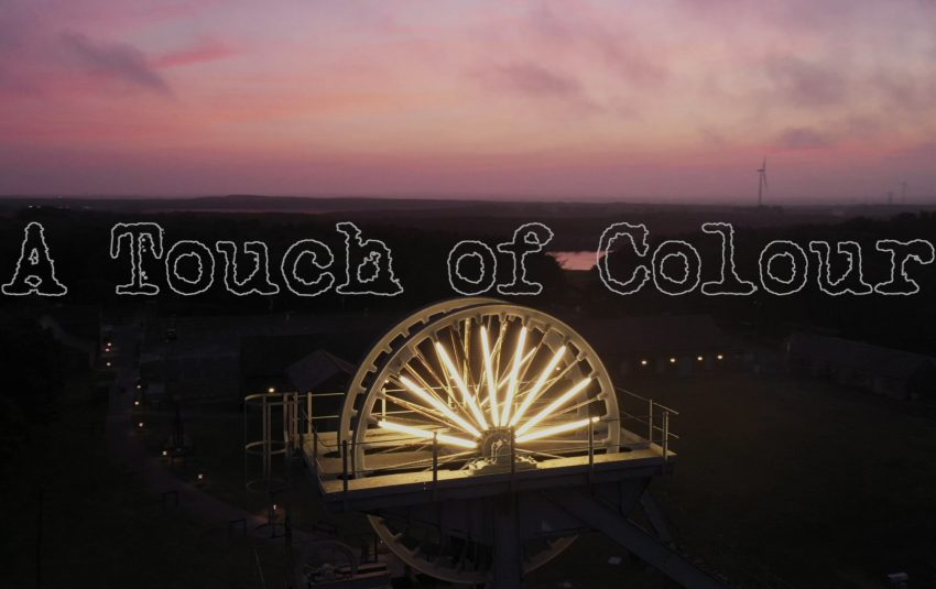 A Touch of Colour intro - aerial image of Woodhorn Museum at sunset