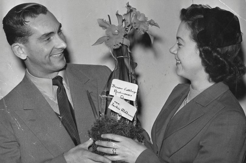 Jackie Milburn and his wife with the orchid named in honour of the Newcastle United footballer