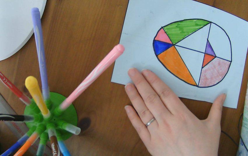 an egg tangram being created