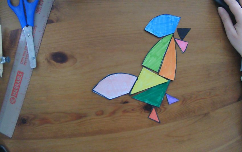 an egg tangram reconstructed into the shape of a chicken