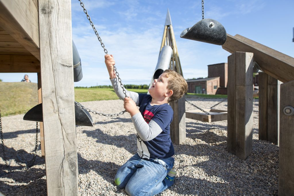 Photograph of a young boy in a playground at Woodhorn Museum